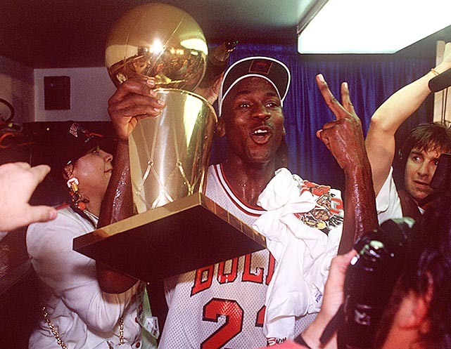 Jordan celebrates the Bulls' repeat at NBA champions after dropping the Portland Trail Blazers in six games. He earned his third MVP Award and second consecutive Final MVP.