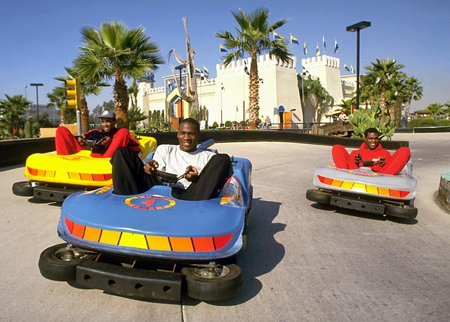 Jordan drives a bumper car against Bulls teammates Rod Higgins and Orlando Woolridge at an amusement park in Phoenix in November 1984.