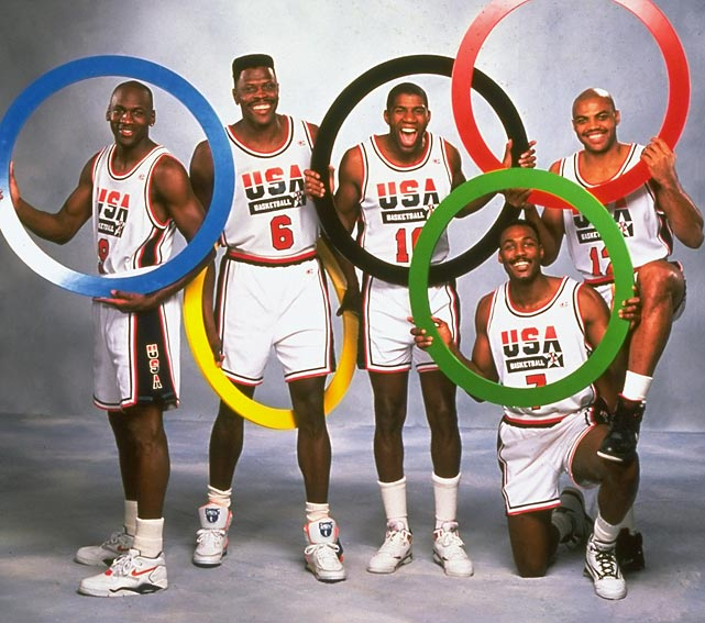 Members of the Dream Team Michael Jordan, Patrick Ewing, Magic Johnson, Karl Malone and Charles Barkley hold up Olympic rings for a portrait in February 1991.