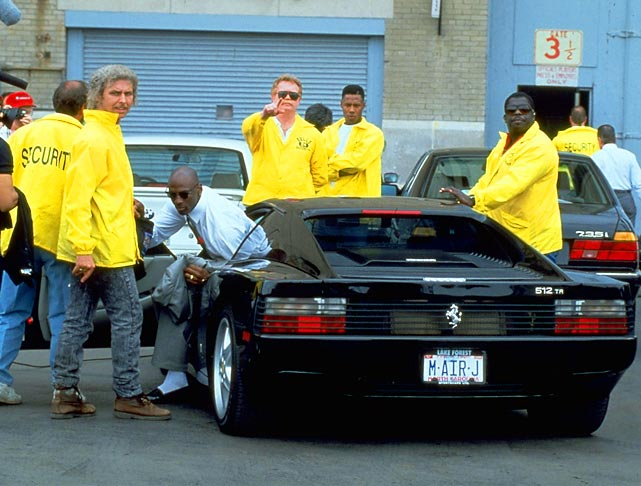 Security guards crowd around Jordan as he gets out of his Ferrari to enter Chicago Stadium in May 1992.