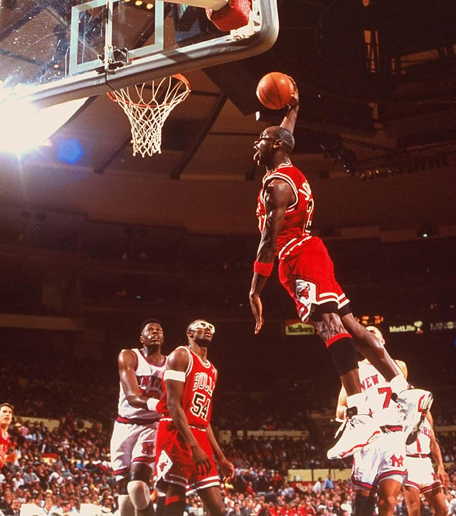 Jordan soars for a slam against the Knicks in April 1991. He scored 34 points with eight rebounds, four assists and three steals in the Bulls' win in New York.