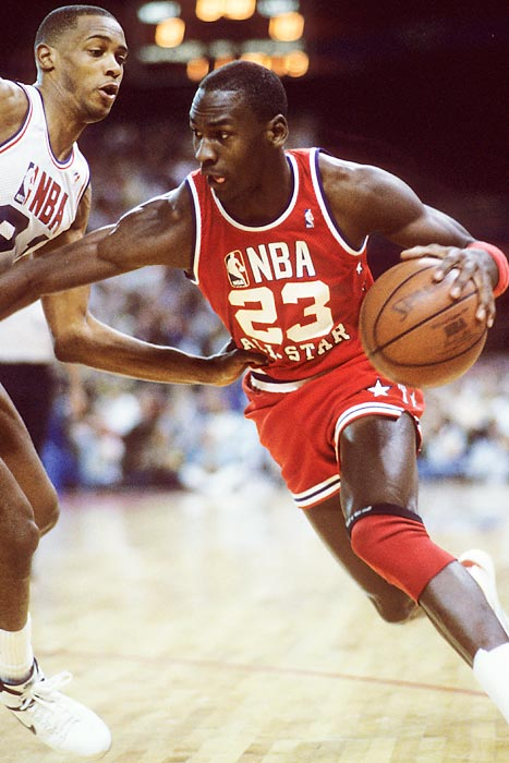 Jordan drives with the ball in the 1987 All-Star Game. He earned his third straight All-Star selection and became the only player other than Wilt Chamberlain to score 3,000 points in a season. He also became the first player to record 200 steals and 100 blocks in a season.