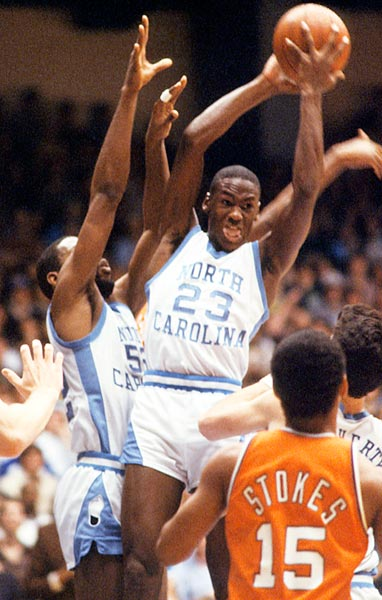 Jordan pulls down a rebound in an ACC game against Virginia in January 1982. He scored 13.5 points per game that season as a freshman and hit the game-winning jumper in North Carolina's national championship victory over Georgetown.