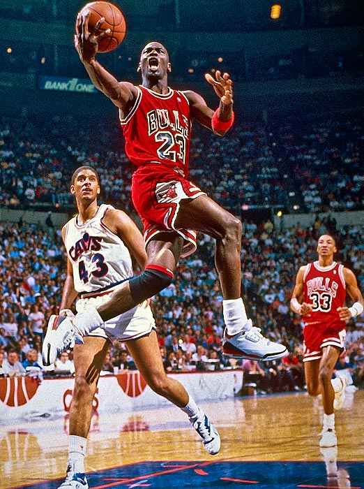 Jordan goes up for a layup after blowing past Brad Daugherty of the Cleveland Cavaliers in Game 4 of a first-round playoff series in May 1988. Jordan torched Cleveland for 38 or more points in each game of the series, but the Bulls couldn't get past the Detroit Pistons in the next round.
