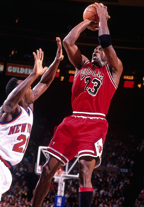 Jordan takes a fadeaway jumper against the New York Knicks in Game 4 of the Eastern Conference semifinals in 1992. He averaged 31.3 points during the series, capping it off with a 42-point performance in Game 7 to advance to the Eastern Conference Finals.