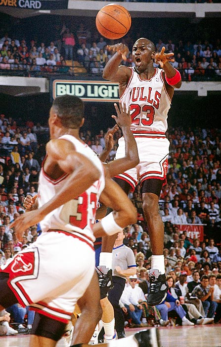 Jordan makes a midair pass to Scottie Pippen against the Detroit Pistons in Game 3 of the 1990 Eastern Conference Finals. Jordan's 47 points and 10 rebounds got the Bulls the win in that game, but the Pistons took the series in seven games.