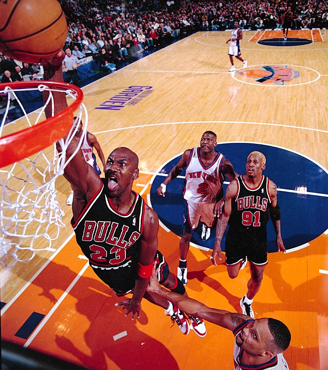 Jordan throws down a dunk against the New York Knicks in March 1998. Jordan dominated the Knicks in the Bulls' 102-89 victory, amassing 42 points, eight rebounds, six assists and three steals.
