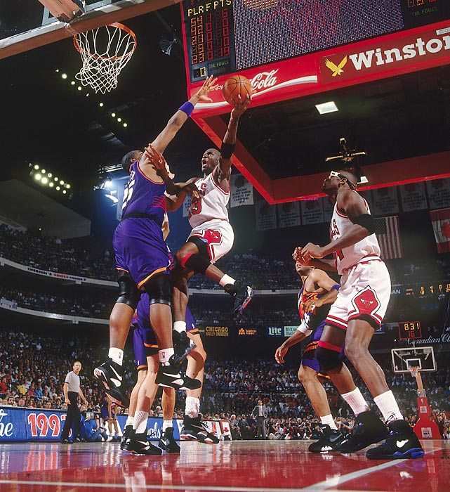 Jordan rises up to the hoop against the Phoenix Suns in Game 4 of the 1993 NBA Finals. Jordan shrugged off the building off-court controversy about his gambling habits to lead the Bulls to their third straight championship.