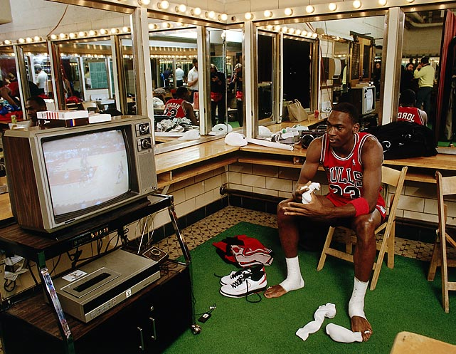 Jordan watches video before a game against the Bucks in 1988 at the Bradley Center in Milwaukee.