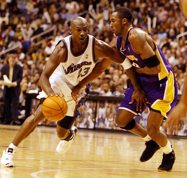 Michael Jordan drives against Kobe Bryant in a November 2002 matchup between the Wizards and the Lakers. Although nearly 40 at the time to Bryant's 24, Jordan matched Bryant's output with 25 points to the Laker guard's 27 in a 100-99 Wizards win.
