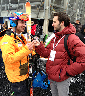 NBC Olympic researcher Alex Goldberger interviews Canadian skier Jan Hudec at the alpine skiing world championships.