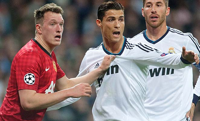 Phil Jones (left) was charged with the unenviable task of containing Cristiano Ronaldo on Wednesday.