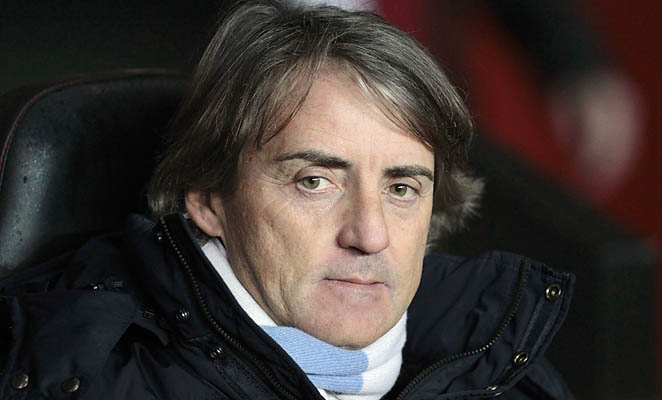 Roberto Mancini and Manchester City are in second place in the Premier League, well back of United.