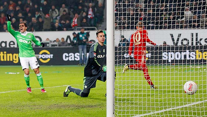 Arjen Robben (right) scores Bayern Munich's second goal in the 2-0 victory.