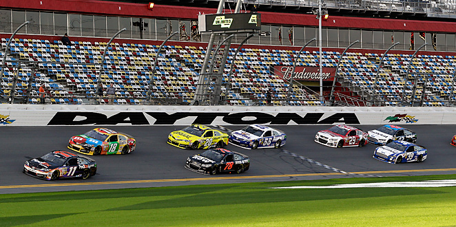 Denny Hamlin and Kyle Busch lead a group through the front stretch during Friday's practice.