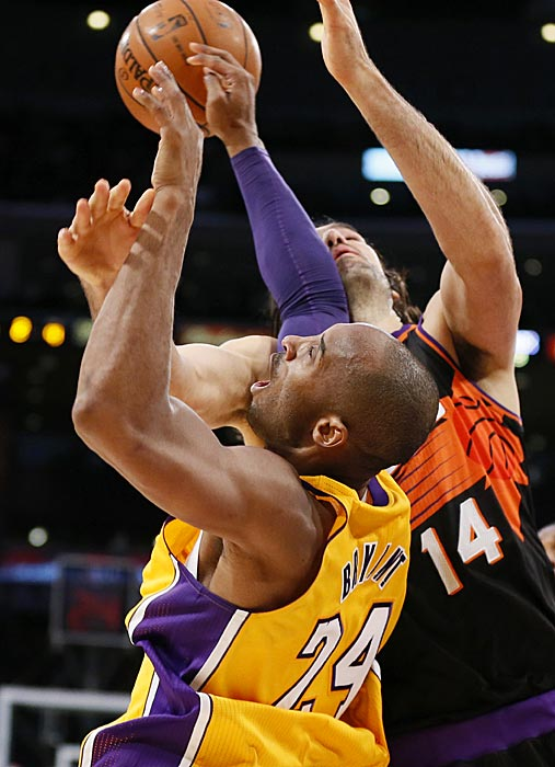 Kobe Bryant and Luis Scola exchange blows to the chin.