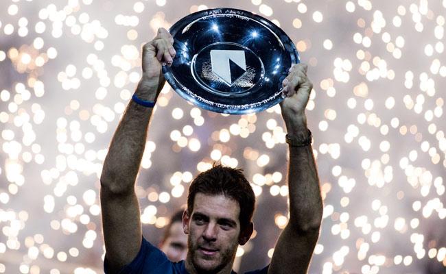 Juan Martin del Potro celebrates his ABN AMRO World Tennis Tournament victory in Rotterdam.