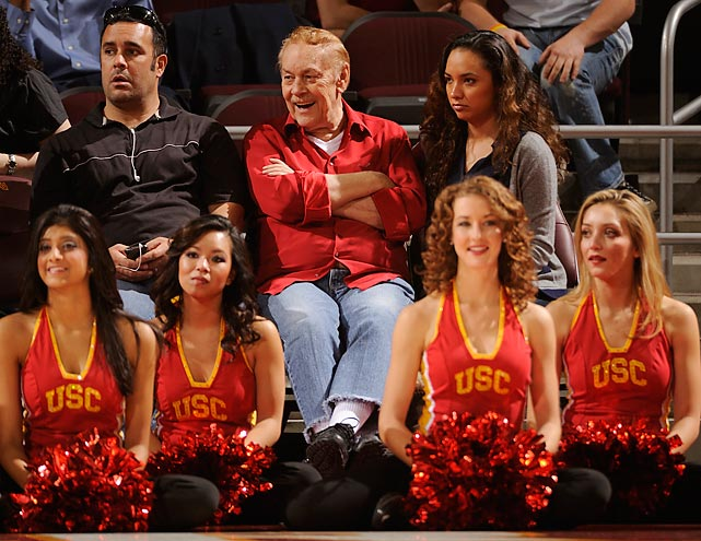 Buss watches the Southern California men's basketball team take on Tennessee from his courtside seat at the Galen Center in December 2009. Buss got a Ph.D. in physical chemistry from USC and served on the faculty before finding fortune on the real estate market and buying the Lakers. He donated $7.5 million to the school's chemistry department in 2008.