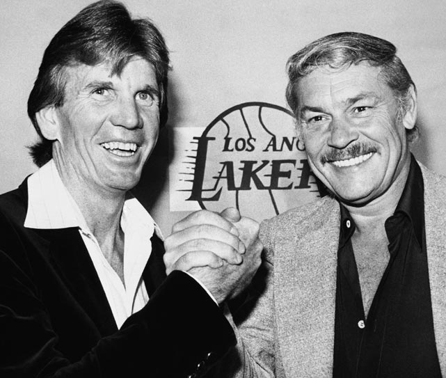 Buss shakes hands with Lakers coach Paul Westhead in April 1980. Westhead guided the Lakers to their first championship under Buss, in 1980. Buss replaced Westhead midway through the 1981-82 season to promote assistant coach Pat Riley.