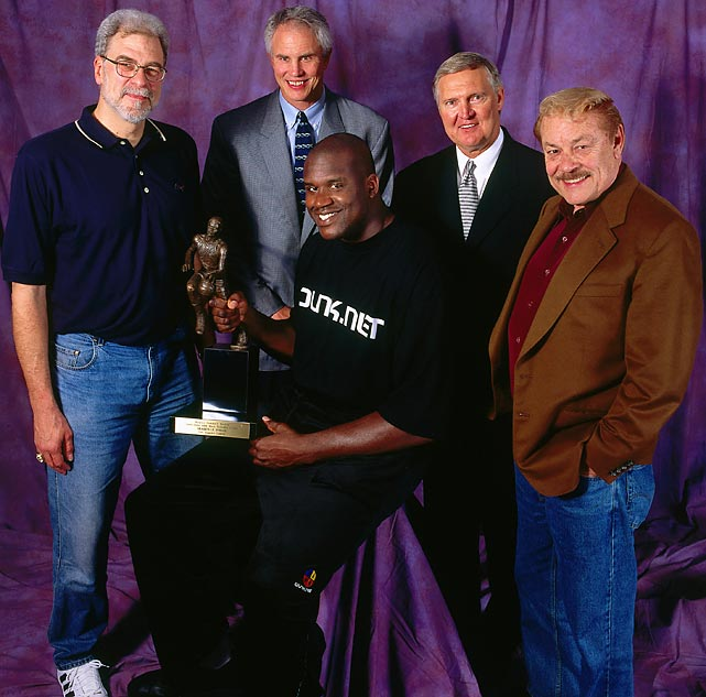 Shaquille O'Neal holds his MVP trophy, surrounded by Phil Jackson, Jerry West and Buss in May 2000. O'Neal and Kobe Bryant initiated a new era of success for the Lakers, winning the first of three straight championships in 2000 to end a nine-year dry spell.
