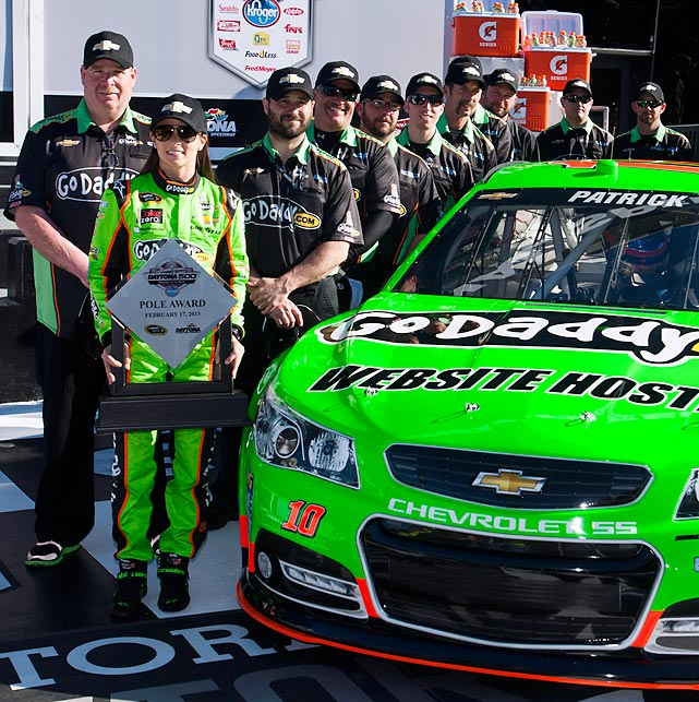 Danica Patrick stands with her crew after winning the pole for the Daytona 500. Patrick became the first woman to win a pole in a NASCAR Sprint Cup Series event, turning in the fastest lap at 196.434 mph.