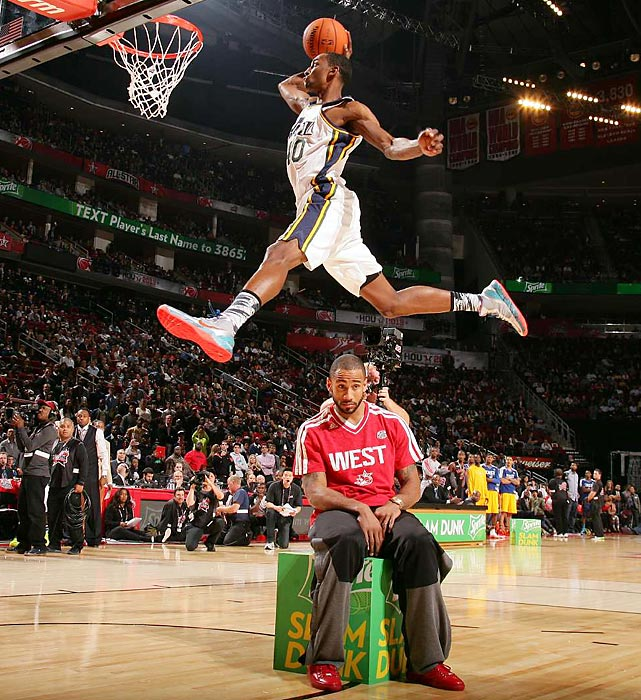Jeremy Evans dunks over Dallas Mavericks guard Dahntay Jones during the 2013 NBA Dunk Contest on Feb. 16. Evans made the finals of the dunk contest but lost to Toronto Raptors rookie Terrence Ross in the fan vote 58 percent to 42 percent.