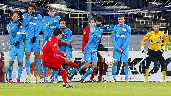 Luis Suarez takes a free kick in Liverpool and Zenit St. Petersburg's first leg last week.