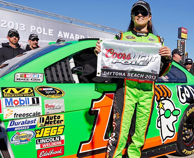 The first woman to win the Daytona 500 pole displays the coveted prize awarded for the achievement.