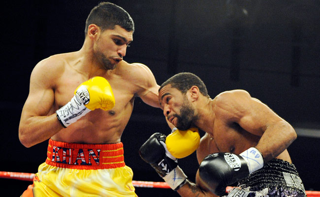 Lamont Peterson's last fight was a 12-round victory over Amir Khan (left) in December 2011.