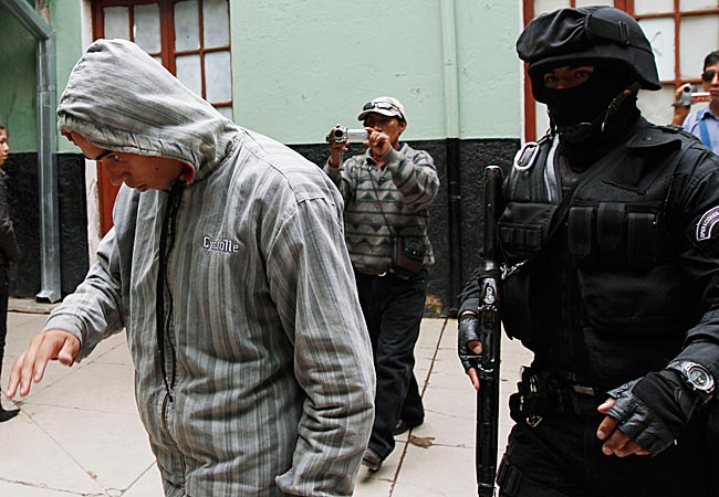 Twelve Corinthian soccer fans were arrested on suspicion of having caused the death of a 14-year-old San Jose soccer fan by launching an explosive device during a Copa Libertadores game.