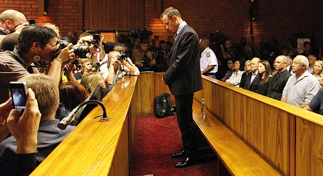 Oscar Pistorius stands in the dock at his bail hearing at the magistrates court in Pretoria on Feb. 22.