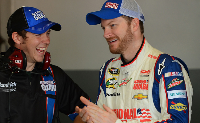 Dale Earnhardt Jr., here talking with a crew member, turned the fast lap by averaging 198.592 mph.