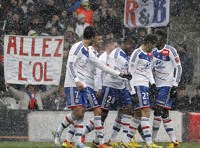 Lyon players celebrate a goal during their win over Lorient. Lyon remains near the top of the table.