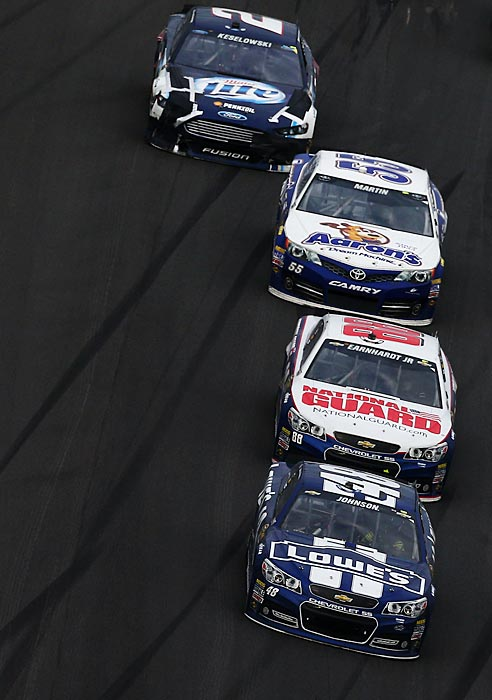 Jimmie Johnson held off Dale Earnhardt Jr., who finished second, while Mark Martin took third.