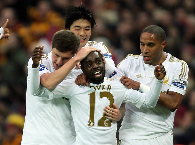 Swansea City's Nathan Dyer celebrates after scoring in his team's 5-0 rout of Bradford City.