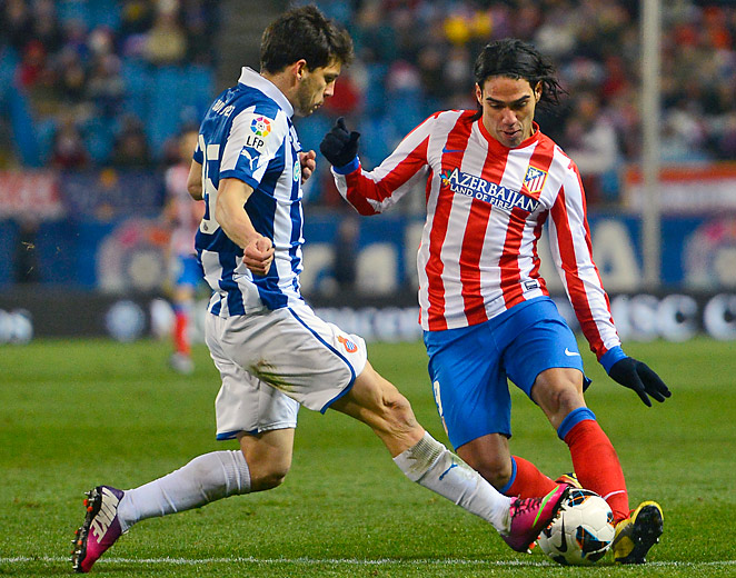 Radamel Falcao (right) helped ensure 10-man Atletico Madrid stayed in second place in La Liga.