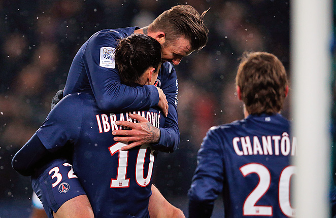 David Beckham celebrates with goal-scorer Zlatan Ibrahimovic after Paris Saint-Germain took a 2-0 lead.