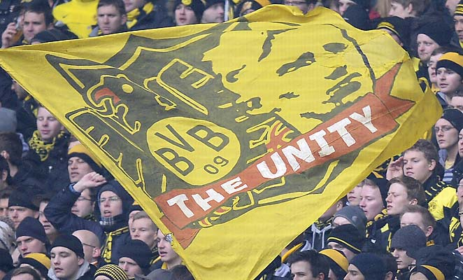 Fans of Borussia Dortmund wave flags in the corner during Sunday's Bundesliga match.