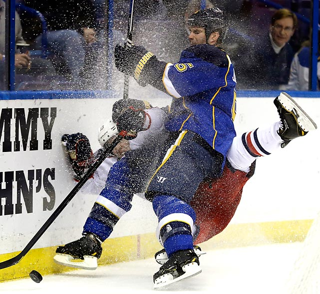 St. Louis Blues defenseman Barret Jackman slams Columbus Blue Jackets right winger Cam Atkinson into the boards as the two chase after a loose puck in the third period of a Feb. 23 game. The Blues won 2-1, ending a five-game home losing streak.