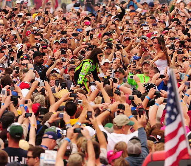 Danica Patrick greats the throng of fans on her way to her car before the 55th running of the Daytona 500 on Feb. 24. Patrick became the first woman to win the pole at a NASCAR Sprint Cup Series event, and she finished eighth in the race. That was the best ever finish by a woman at the Daytona 500, and she made history as the first woman to lead a lap in the historic race.