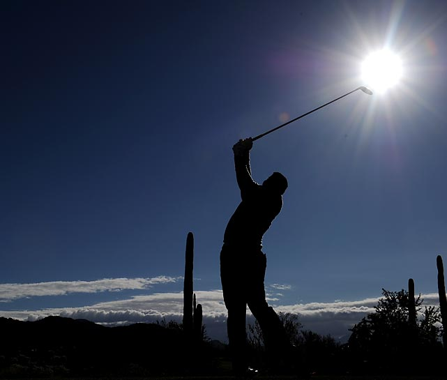 Hunter Mahan hits his tee shot on the ninth hole during the semifinal round at the Accenture Match Play Championships at the Golf Club at Dove Mountain in Marana, Ariz. Mahan defeated Ian Poulter 4 and 3 to earn the right to defend his Match Play title against Matt Kuchar, who claimed this year's championship.