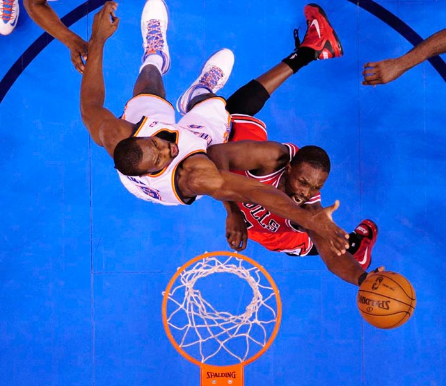 The Chicago Bulls and the Oklahoma City Thunder fight for a rebound in their Feb. 24 matchup at the Chesapeake Energy Arena. The Thunder routed the Bulls 102-72 as Chicago shot just 29 percent from the floor. Oklahoma City point guard Russell Westbrook led all scorers with 23 points.