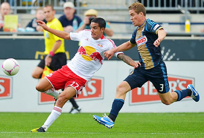 Tim Cahill (left) fights for the ball with Philadelphia's Chris Albright in a game last season.