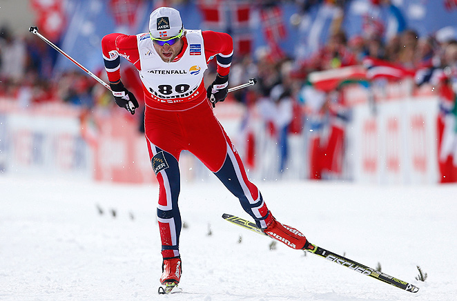 Norway's Petter Northug beat Johan Olsson by 11.8 seconds to win the 15k individual freestyle event.