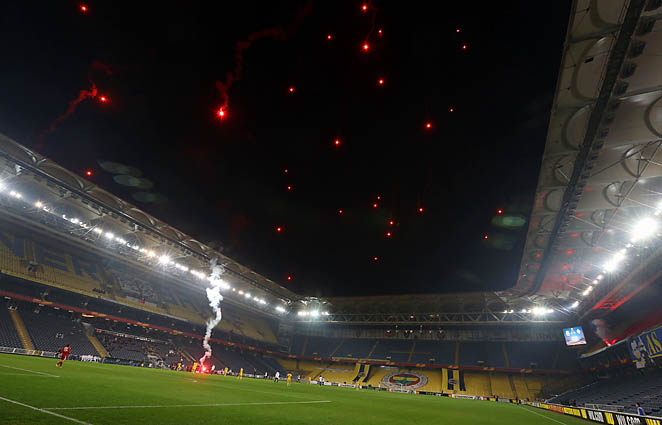 Fireworks by thousands of Turkish fans fly over the stadium at the end of the game between Fenerbahce and BATE last week.