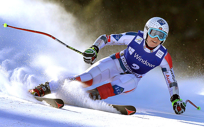 Liechtenstein's Tina Weirather beat Julia Mancuso and Tina Maze by .12 of a second in the World Cup super-G event.