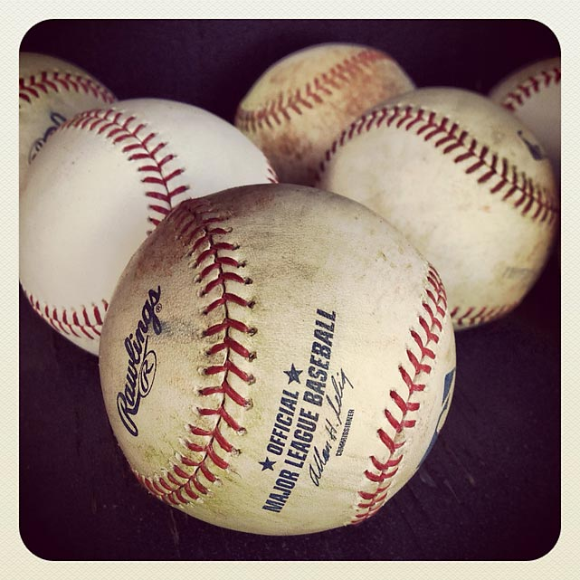 Baseballs in the Royals dugout before a spring training game against the Padres in Peoria.