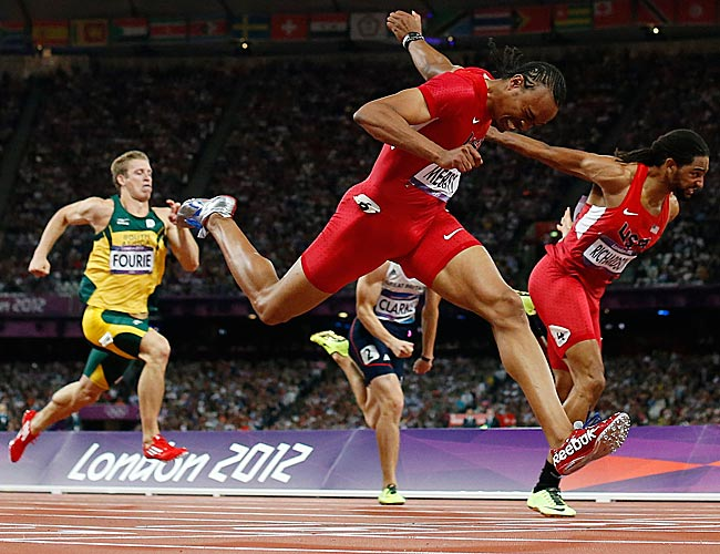 United States' Aries Merritt, center, crosses the finish line ahead of United States' Jason Richardson, right, to win gold in the men's 110-meter hurdles final at the 2012 Summer Olympics in London.