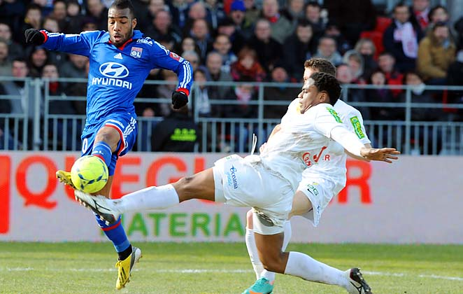 Brest's French midfielder Tripy Makonda (right) vies with Lyon's Argentinian forward Lisandro Lopez.