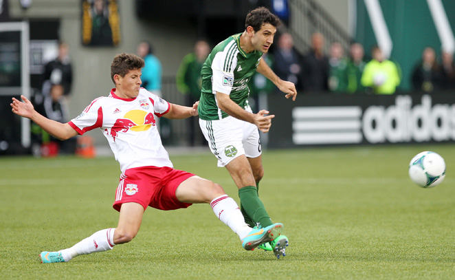 The Red Bulls' Ruben Bover and the Timbers' Diego Valeri battle for possession of the ball.